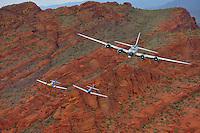 Boeing B-17 Bomber & P-51 Mustangs pass over Arizona's desert.