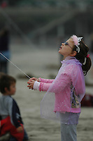 A young girl flies a kite on the beach during the 60th annual Ocean Beach Kite Festival, Craft Fair and Parade on Saturday, March 1, 2008.