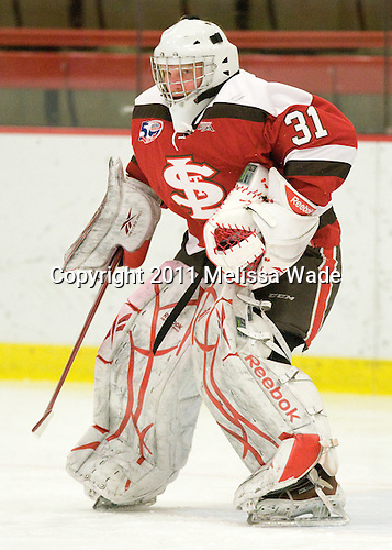 Joe Spadaccini (St. Lawrence - 31) - The Harvard University Crimson defeated the St. Lawrence University Saints 4-3 on senior night Saturday, February 26, 2011, at Bright Hockey Center in Cambridge, Massachusetts.