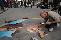 Michael McCollum.3/19/13.Artist Matteo Appignani draws renditions of Michelangelo's paintings with colored chalk on a street near the marketplace in Florence. He started the project at 10am and hoped to be done by 9pm that night..