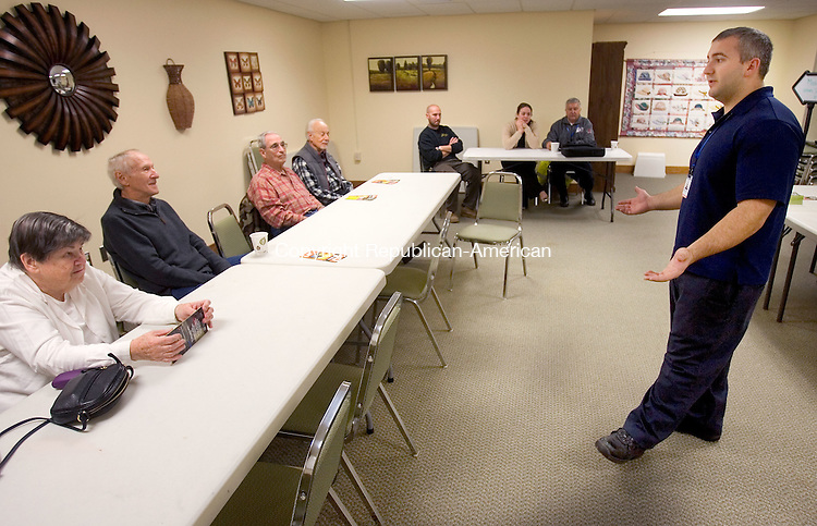 WATERBURY CT. 27 October 2014-102714SV01-Derrek Guertin, deputy fire marshal, gives a fire prevention talk to seniors at the senior center in Southbury Monday. <br /> Steven Valenti Republican-American