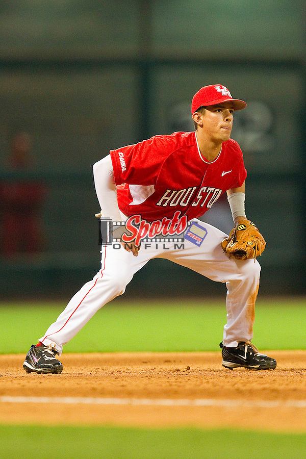 Third baseman Jake Runte #13 of the Houston Cougars on defense against the Kentucky Wildcats at Minute Maid Park on March 5, 2011 in Houston, Texas.  Photo by Brian Westerholt / Four Seam Images