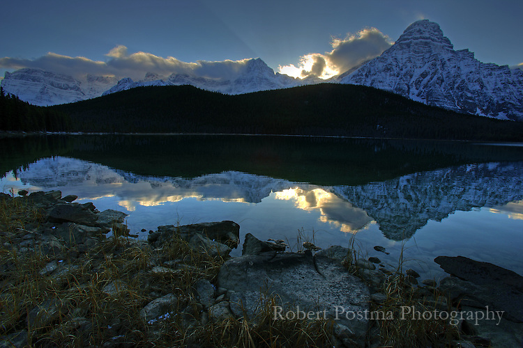 Shaft of sunlight reflected in unnamed lake, Banff National Park.
