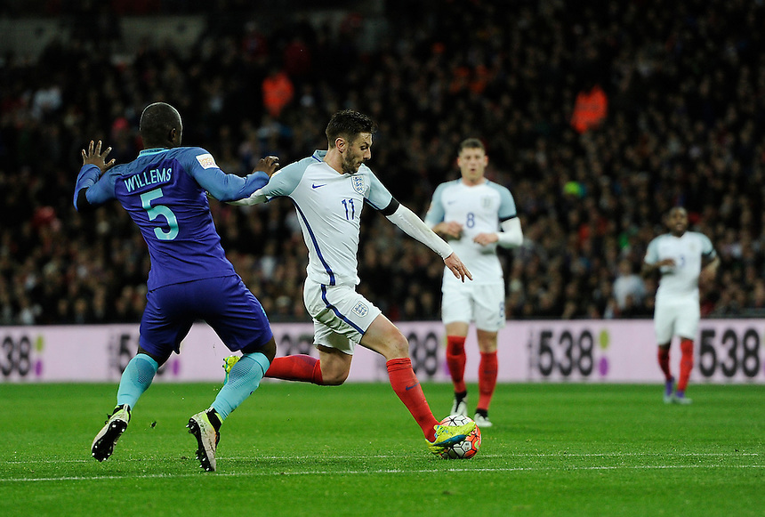 England's Adam Lallana  holds off the challenge from Holland's Jetro Willems <br /> <br /> Photographer AshleyWestern/CameraSport<br /> <br /> Football - Breast Cancer Care International Friendly - England v Holland - Tuesday 29th March 2016 - Wembley Stadium - London<br /> <br /> &copy; CameraSport - 43 Linden Ave. Countesthorpe. Leicester. England. LE8 5PG - Tel: +44 (0) 116 277 4147 - admin@camerasport.com - www.camerasport.com