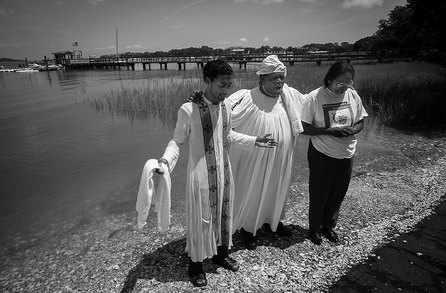 The Rev. Ben Williams, pastor of Mt. Calvary Missionary Baptist Church, leads members in prayer before a traditional Gullah Geechee river baptism ceremony on Hilton Head Island.