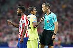 Spanish referee Guillermo Cuadra Fernandez have words with Getafe CF's Damian Suarez (c) in presence of Atletico de Madrid's Thomas Lemar during La Liga match. August 18,2019. (ALTERPHOTOS/Acero)