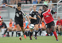 BOYDS, MARYLAND - July 21, 2012:  Lianne Sanderson (10) of DC United Women slots a pass past Samantha Hare (22) of the Virginia Beach Piranhas during a W League Eastern Conference Championship semi final match at Maryland Soccerplex, in Boyds, Maryland on July 21. DC United Women won 3-0.