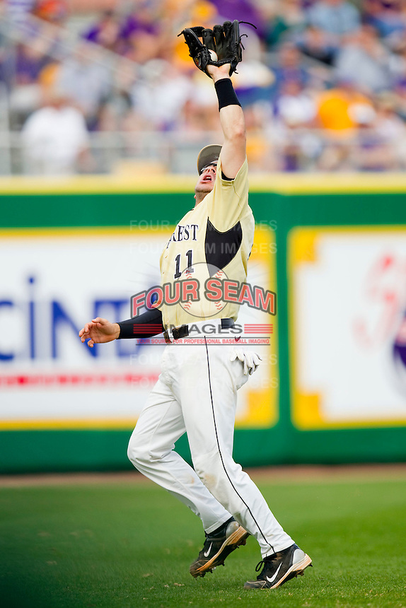 Shortstop Pat Blair #11 of the Wake Forest Demon Deacons makes a catch in shallow left field against the LSU Tigers at Alex Box Stadium on February 20, 2011 in Baton Rouge, Louisiana.  The Tigers defeated the Demon Deacons 9-1.  Photo by Brian Westerholt / Four Seam Images