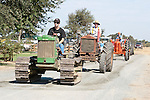 Annual fall Gas-Up at McFarland Ranch near Galt, Calif. of Branch 13, Early-Day Gas Engine and Tractor Association. (EDGE & TA)..Mid 1950s John Deere crawler tractor followed by an early Cletrac wheeled tractor