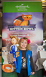 Wantagh, New York, USA. 7th February 2016. LUCY B, 5, of Merrick, holds a balloon lady while standing in front of big Kitten Bowl poster during Hallmark Channel Kitten Bowl III, Last Hope Animal Rescue has an Open House where the adoption center's volunteers and visitors watch the game on TV and cheer on their team, the Last Hope Lions. Over 100 adoptable kittens from Last Hope Inc and North Shore Animal League America participated in the games, and the Home and Family Felines won the 2016 championship, which first aired the day of Super Bowl 50.