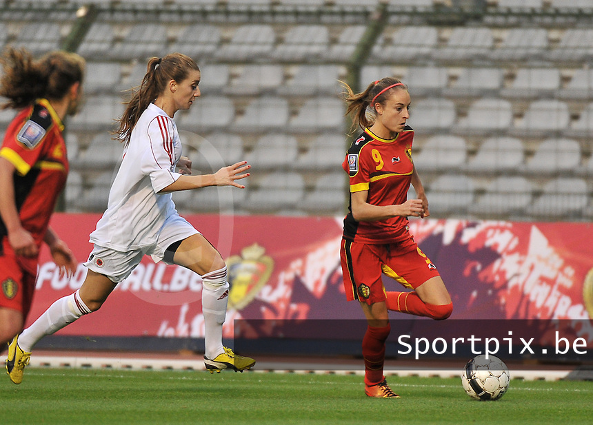 20130921 - BRUSSELS , BELGIUM : Belgian Tessa Wullaert (9) pictured with Albanian Memedov Dafina (Left) during the female soccer match between Belgium and Albania , on the first matchday in group 5 of the UEFA qualifying round to the FIFA Women World Cup in Canada 2015 at the Koning Boudewijn Stadion , Brussels . Saturday 21th September 2013. PHOTO DAVID CATRY