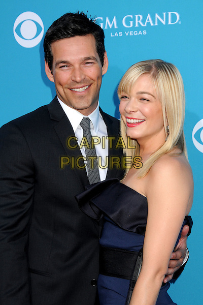 EDDIE CIBRIAN & LEANN RIMES.45th Annual Academy Of Country Music Awards - Arrivals held at the MGM Grand Garden Arena, Las Vegas, Nevada, USA..April 18th, 2010.ACM half length couple black suit grey gray tie white shirt navy blue strapless ruffle dress arm around smiling .CAP/ADM/BP.©Byron Purvis/AdMedia/Capital Pictures.