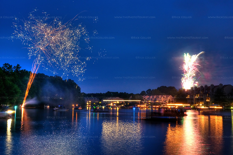 US Independence Day Fireworks over Lake Thoreau, Reston, Virginia.  As dark falls, everyone who has a boat or floating dock embarks to enjoy the show as lakeside residents treat one another to a spectacular impromptu fireworks show over the lake.  © Rick Collier.