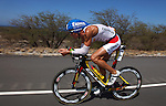 "KAILUA-KONA, HAWAII - OCTOBER 9:  A competitor during the Ironman World Championships in Kailua-Kona, Hawaii on October 9, 2009. Considered one of the most grueling races in the world, competitors must brave 95 degrees temperature and 90 percent humidity to complete a 3.86 km swim, 180.2 km bike, and a 42.2 km marathon with in an 17 hour time cutoff to be called an ""Ironman"". (Photo by Donald Miralle)"