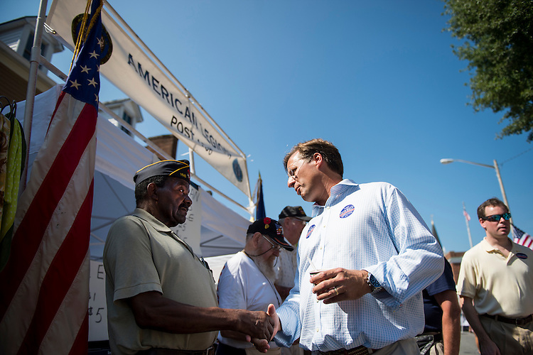 UNITED STATES - SEPTEMBER 6: Dave Brat, Republican candidate for Congress from Virginia's 7th district, stops to shakes hands at the American Legion tent during the 39th Annual Orange Street Festival in Orange, Va., on Saturday, Sept. 6, 2014. Brat defeated House Majority Leader Eric Cantor, R-Va., in the Republican primary. (Photo By Bill Clark/CQ Roll Call)