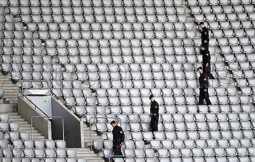 29.03.2016. Munich, Germany.  Police officers check the seating rows before the spectators enter the stadium, for the international soccer  match between Germany and Italy, at the Allianz Arena in Munich, Germany, 29 March 2016.