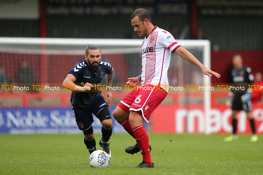 Luke Wilkinson of Stevenage passes the ball to a teammate as Charlton's Ricky Holmes looks on during Stevenage vs Charlton Athletic, Friendly Match Football at the Lamex Stadium on 22nd July 2017