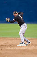 June 8, 2008: Fresno Grizzlies' Brian Bocock steps on second and makes a throw to first base during a Pacific Coast League game against the Tacoma Rainiers at Cheney Stadium in Tacoma, Washington.