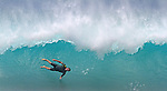 A surfer wipes out on a huge winter wave at  Ehukai Beach (Banzai Pipeline) on the Northshore of Oahu, Hawaii.