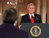 Washington, D.C. - April 28, 2005 -- United States President George W. Bush conducts a prime-time press conference in the East Room at the White House in Washington, D.C. on April 28, 2005.  In prepared remarks, the President discussed his vision for Social Security reform and energy.<br /> Credit: Ron Sachs / CNP