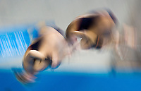 26 JUL 2012 - LONDON, GBR - Sarah Barrow (GBR) (left) and Tonia Couch (GBR) (right) of Great Britain practice at the Aquatics Centre in the Olympic Park, Stratford, London, Great Britain ahead of the London 2012 Olympic Games 10m Synchronised Diving .(PHOTO (C) 2012 NIGEL FARROW)