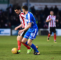 Lincoln City's Jordan Williams vies for possession with  Notts County's Shaun Brisley<br /> <br /> Photographer Andrew Vaughan/CameraSport<br /> <br /> The EFL Sky Bet League Two - Lincoln City v Notts County - Saturday 13th January 2018 - Sincil Bank - Lincoln<br /> <br /> World Copyright &copy; 2018 CameraSport. All rights reserved. 43 Linden Ave. Countesthorpe. Leicester. England. LE8 5PG - Tel: +44 (0) 116 277 4147 - admin@camerasport.com - www.camerasport.com