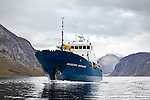 The Arctic expedition ship, Akademik Shokakskiy sails the Tasermiut fjord, Greenland.