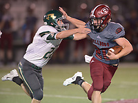 NWA Democrat-Gazette/ANDY SHUPE<br /> Springdale running back Garrett Vaughan (right) fends off Alma linebacker Logan Chronister Friday, Sept. 7, 2018, during the first half at Jarrell Williams Bulldog Stadium in Springdale. Visit nwadg.com/photos to see photographs from the game.