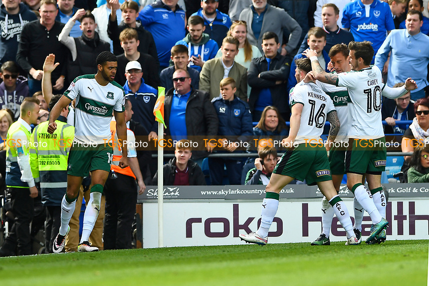 Plymouth Argyle players right go to celebrate with goalscorerJake Jervis of Plymouth Argyle left during Portsmouth vs Plymouth Argyle, Sky Bet EFL League 2 Football at Fratton Park on 14th April 2017