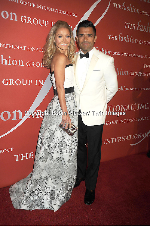 Kelly Ripa in Carolina Herrera dress and Mark Consuelos attends the Fashion Group International's 29th Annual  Night of Stars Gala on October 25, 2012 at Cipriani Wall Street in New York City.