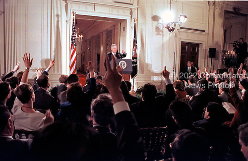 United States President Bill Clinton calls on a reporter during his press conference in the East Room of the White House on 16 February, 2000.<br /> Credit: Ron Sachs / CNP