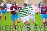 Listowel Celtic's Chris Mason and Spa Road FC's Joe Duggan.