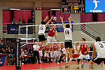 29 APR 2012:  Angel Perez (15) of Springfield College jumps for a block against Pat Berry (13) of Carthage College during the Division III Men's Volleyball Championship held at Blake Arena in Springfield, MA.  Springfield defeated Carthage 3-0 to win the national title.  Jessica Rinaldi/NCAA Photos