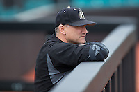 Bryant Bulldogs head coach Steve Owens (30) watches his team warm up prior to the game against the Coastal Carolina Chanticleers at Springs Brooks Stadium on March 13, 2015 in Charlotte, North Carolina.  The Chanticleers defeated the Bulldogs 7-2.  (Brian Westerholt/Four Seam Images)