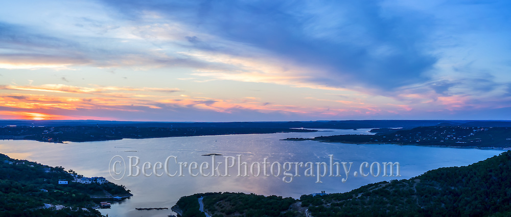 This is an aerial panorama image taken at sunset as the last peak of sometimes island is still visible on Lake Travis outside of Austin. It was expected to underwater for the first time since 2010, but we never got enough rain, maybe this fall. You can see the boats going over what use to be land and the colorful sunset gave a nice farewell to the island.  It is wonderful to see the lake this full again, we hope it will last,