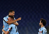 Football, Serie A: S.S. Lazio - Cagliari, Olympic stadium, Rome, July 23, 2020. <br /> Lazio's Sergej Milinkpvic-Savic (c) celebrates after scoring with his teammate Luiz Felipe Ramos (l) and Marco Parolo (r) during the Italian Serie A football match between Lazio and Cagliari at Rome's Olympic stadium, Rome, on July 23, 2020. <br /> UPDATE IMAGES PRESS/Isabella Bonotto