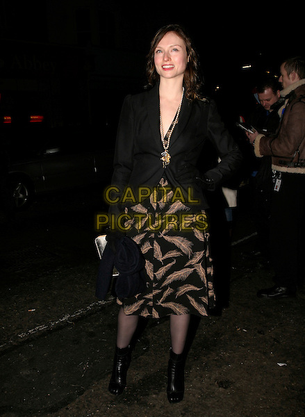 SOPHIE ELLIS BEXTOR.Grand Classics - Annie Hall - private VIP screening at the Electric Cinema Cinema, London, UK..December 12th, 2005.Ref: Ah.full length black jacket feather pattern print skirt black ankle boots.www.capitalpictures.com.sales@capitalpictures.com.©Capital Pictures