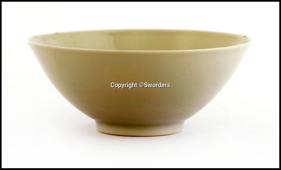 BNPS.co.uk (01202 558833)<br /> Pic: Sworders/BNPS<br /> <br /> A 300 year old tiny tea bowl bought for £20 by a British traveller in China in the 1980's has sold for a whopping £40,000.<br /> <br /> Made during the reign of Emperor Yongzheng of the Qing Dynasty between 1723-35 the simple vessel represents a high point in Chinese cup design.<br /> <br /> Auctioneers Sworders had given the simple item a conservative £8000 estimate but frenzied bidding from several Chinese bidders who had flown in caused it to soar to £40,000.