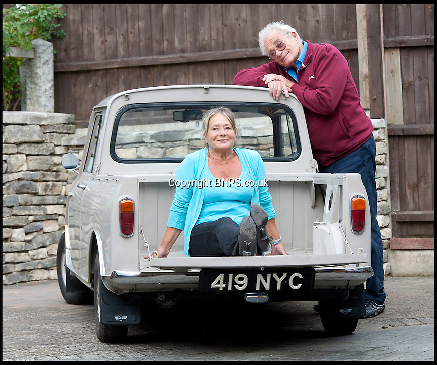 BNPS.co.uk (01202) 558833<br /> Picture: LauraJones/BNPS<br /> <br /> Owners of the Mini pickup truck Margaret and Fred Gould from Broadstone, Poole, Dorset.<br /> <br /> A classic Mini pickup truck is being sold for only the second time in its life with a pre-sale estimate of &pound;13,000.<br /> <br /> The 1961 open back vehicle has been owned by the same family since its was bought new by farmer Minnie Gould who used it to transport calves to market. <br /> <br /> It was given a new lease of life 30 years later by her son Fred who had it recommissioned and resprayed.