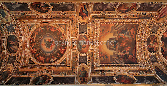 Vaulted ceiling painted by Martin Freminet, 1567-1619, begun 1606, with the theme of the Redemption of Man, in La Chapelle de la Trinite or Chapel of the Trinity, 16th century, originally a monastery church belonging to the Mathurin monks under Saint Louis and re-annexed to the chateau under Francois I, Chateau de Fontainebleau, France. The paintings depict the Appearance of God with Noah, the Annunciation, and Christ at the Last Judgement, surrounded by kings de Judah, the prophets and the virtues. The proto-baroque decor is of the Second Ecole de Fontainebleau style. The Palace of Fontainebleau is one of the largest French royal palaces and was begun in the early 16th century for Francois I. It was listed as a UNESCO World Heritage Site in 1981. Picture by Manuel Cohen