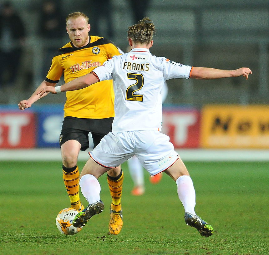 Newport County's Lee Minshull under pressure from Luton Town's Fraser Franks<br /> <br /> Photographer Craig Thomas/CameraSport<br /> <br /> Football - The Football League Sky Bet League Two - Newport County AFC v Luton Town - Tuesday 17th March 2015 - Rodney Parade - Newport<br /> <br /> &copy; CameraSport - 43 Linden Ave. Countesthorpe. Leicester. England. LE8 5PG - Tel: +44 (0) 116 277 4147 - admin@camerasport.com - www.camerasport.com