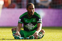 Ashley Williams looks dejected during the Barclays Premier League match between Southampton v Swansea City played at St Mary's Stadium, Southampton