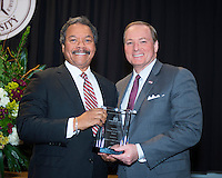 Mississippi State University President Mark E. Keenum (right) presents the 2017 National Alumnus of the Year award to Herbert V. &quot;Herb&quot; Johnson of Houston, Texas, during Friday's [Feb. 3] MSU Alumni Association awards banquet. The engineering graduate is president of HVJ Associates, Inc., which he founded in 1985.<br />