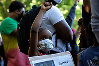 A child raises their fist in the air during a protest in Lafayette Square across from the White House in Washington, D.C., U.S., on Sunday, May 31, 2020, following the death of an unarmed black man at the hands of Minnesota police on May 25, 2020.  Credit: Stefani Reynolds / CNP/AdMedia