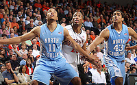 North Carolina forward Brice Johnson (11) and North Carolina forward James Michael McAdoo (43) looks for the rebound with Virginia forward Akil Mitchell (25) during an NCAA basketball game Monday Jan. 20, 2014 in Charlottesville, VA. Virginia defeated North Carolina 76-61.