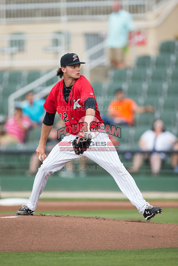 Kannapolis Intimidators starting pitcher Spencer Adams (12) delivers a pitch to the plate against the Greensboro Grasshoppers at CMC-Northeast Stadium on June 9, 2015 in Kannapolis, North Carolina.  The Intimidators defeated the Grasshoppers 6-4.  (Brian Westerholt/Four Seam Images)