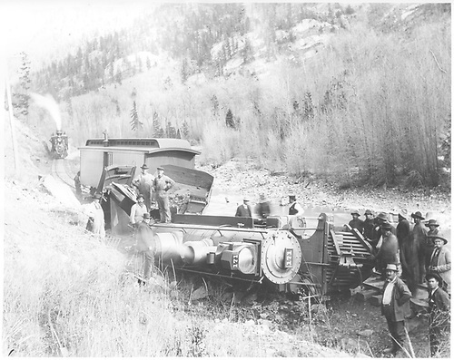D&amp;RG #171 on her side near a derailed baggage car at MP 481.9 near Needleton on the Silverton Branch.<br /> D&amp;RG  Needleton, CO  Taken by Ballough, Monte - 11/27/1903