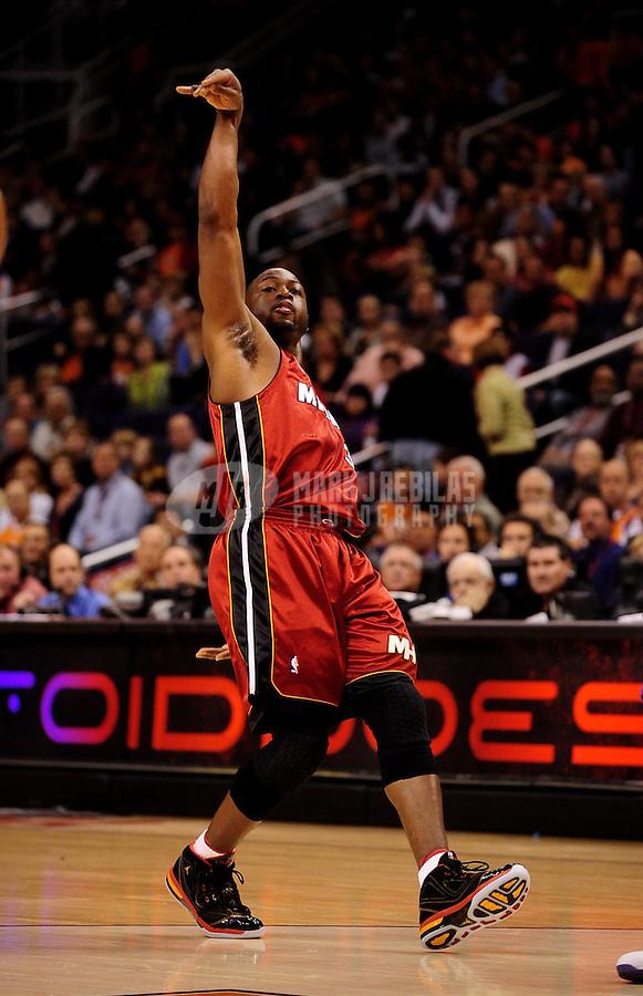 Jan. 8, 2010; Phoenix, AZ, USA; Miami Heat guard (3) Dwayne Wade follows through on a shot against the Phoenix Suns at the US Airways Center. Miami defeated Phoenix 109-105. Mandatory Credit: Mark J. Rebilas-