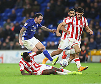 26th November 2019; Cardiff City Stadium, Cardiff, Glamorgan, Wales; English Championship Football, Cardiff City versus Stoke City; Bruno Martins Indi of Stoke City tackles Lee Tomlin of Cardiff City - Editorial Use - Strictly Editorial Use Only. No use with unauthorized audio, video, data, fixture lists, club/league logos or 'live' services. Online in-match use limited to 120 images, no video emulation. No use in betting, games or single club/league/player publications
