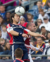 New England Revolution defender AJ Soares (5) and Portland Timbers forward Kris Boyd (9) battle for head ball. In a Major League Soccer (MLS) match, the New England Revolution defeated Portland Timbers, 1-0, at Gillette Stadium on March 24, 2012